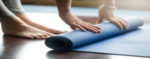 woman and yoga mat