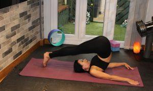 Yoga practicing plough pose